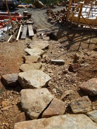 Huge flag stones from the site carefully chosen by Peter to make the stairway down to the house, all with 170mm risers.